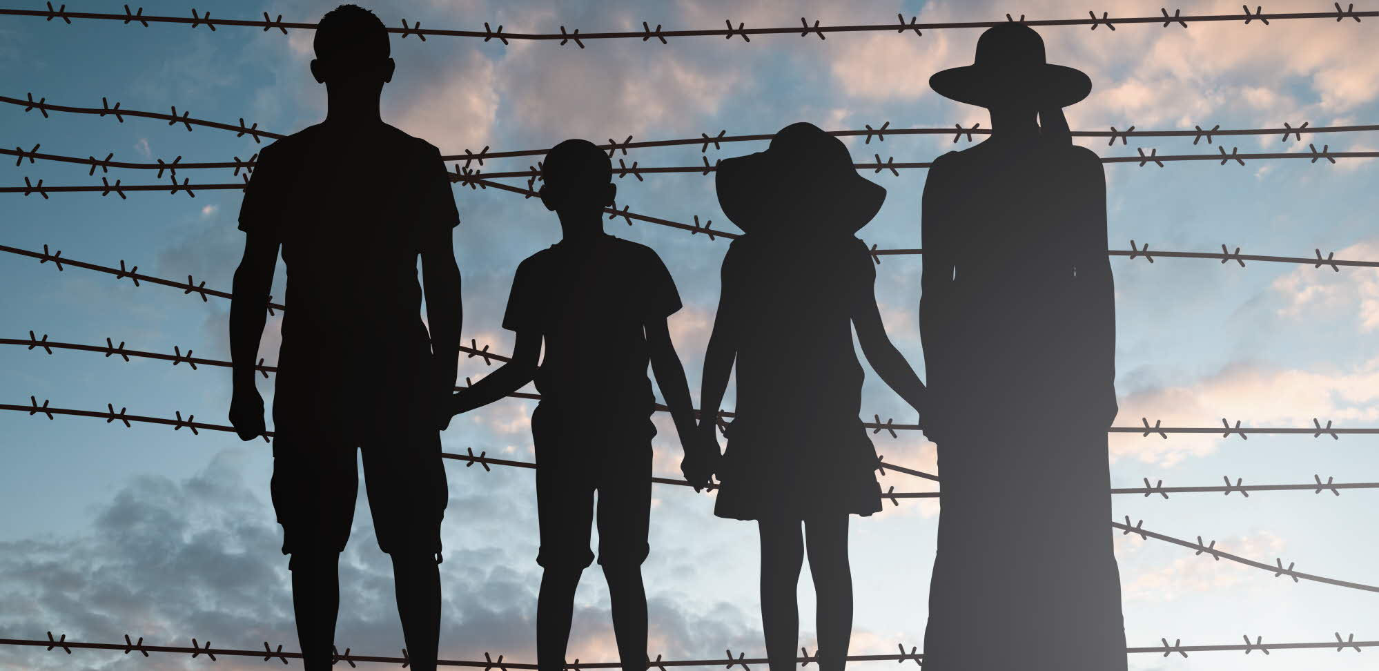 family in silhouette against barbed wire