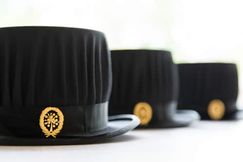 Three doctoral hats