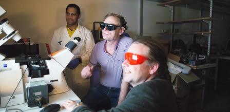 Tim-Otto and Alf with laser safety glasses, checking if the lighting in the microscope works. Venukumar Vemulaobserves in the background.