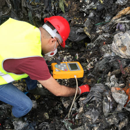 Measuring emitted gases from wastes inside a landfill.