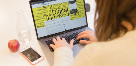 girl in front of computer with the a digital humanities web page visible