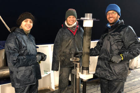 Scientists are working at night to extract samples from plastic tubes that penetrated into the seafloor. Similar to photos 4 and 5 (in the photo from left to right: Mahboubeh Rahmati Abkenar, post doc, Leonie Jaeger, exchange master student from Germany, Sina Shahabi Ghahfarokhi, Ph.D. student).